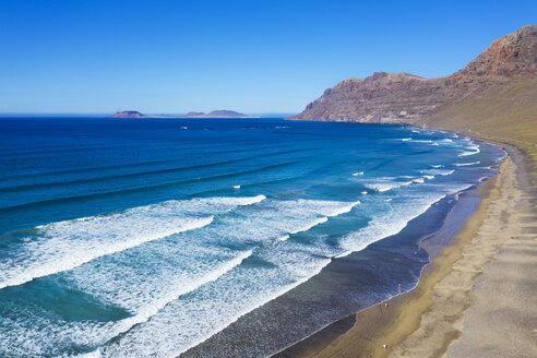Spain, Canary Islands, Lanzarote, Risco de Famara, Playa Famara at Caleta de Famara, in the back the island La Graciosa, aerial view - SIEF08425