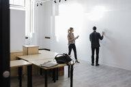 Art gallery owners preparing to hang art - HEROF28630