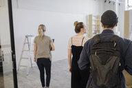 Art gallery owners walking - HEROF28633