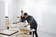 Art gallery owners framing prints - HEROF28645