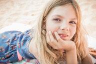 Girl lying on beach, portrait, Los Angeles, USA - CUF49739