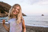 Blond haired girl on beach, portrait, Portoferraio, Tuscany, Italy - CUF49772