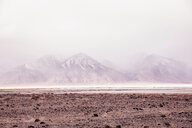 Arid landscape with distant misty mountains, Keeler, California, USA - CUF49796