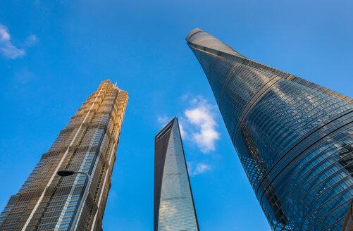 Jin Mao Tower, Shanghai Tower, Shanghai World Financial Centre against blue sky, low angle view, Shanghai, China - CUF49835