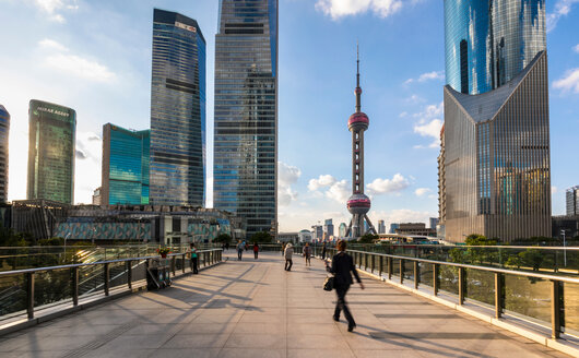 Pudong skyline with Oriental Pearl Tower from elevated walkway, Shanghai, China - CUF49841
