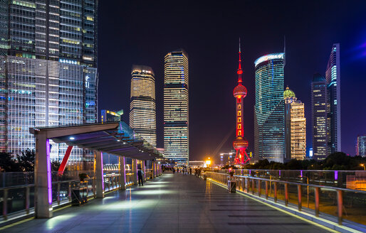 Pudong skyline with Oriental Pearl Tower from elevated walkway at night,  Shanghai, China - CUF49853