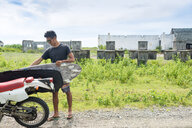 Motorcyclist with surfboard, Abulug, Cagayan, Philippines - CUF49919