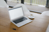 Laptop on desk in office with cup of espresso - JOSF03169