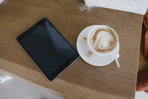 Digital tablet on desk with cup of cappuccino with - JOSF03172
