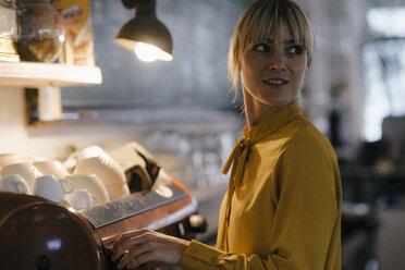 Woman working in coffee shop, portrait - JOSF03202