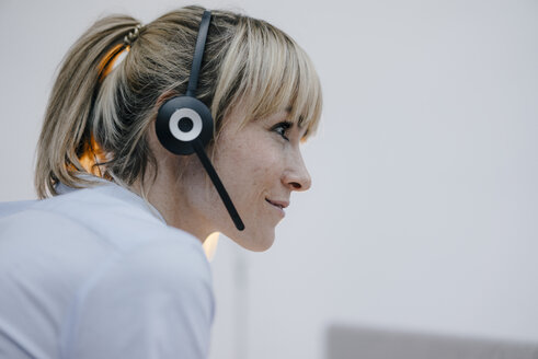 Businesswoman having a conference call with headset - JOSF03211