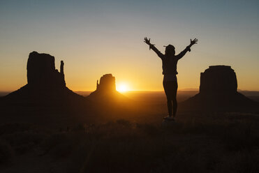 USA, Utah, Monument Valley, silhouette of happy woman enjoying sunrise - GEMF02886