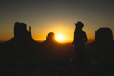 USA, Utah, Monument Valley, silhouette of woman with cowboy hat watching sunrise - GEMF02889