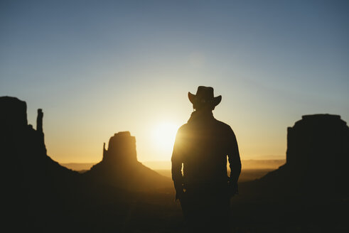 USA, Utah, Monument Valley, silhouette of man with cowboy hat  watching sunrise - GEMF02892