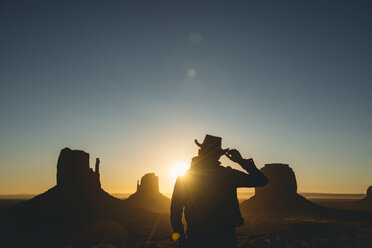 USA, Utah, Monument Valley, silhouette of man with cowboy hat   watching sunrise - GEMF02895