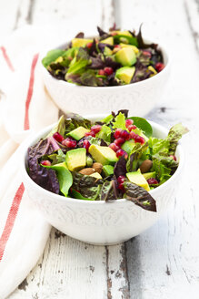 Detox salad bowl with avocado, pomegranate seeds, roasted soybeans, sunflower seeds and nuts - LVF07867