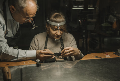 Artisan and his coworker making jewellery in his workshop - AHSF00034
