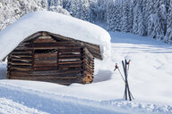 Austria, Salzburg State, Pongau, Wagrein, wooden hut and skis in winter - HAMF00565