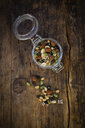 Preserving jar of roasted soy beans, seeds and nuts on wood - LVF07877