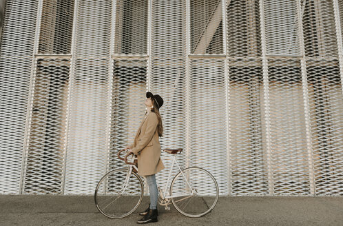 Young hipster woman with a bicycle - AHSF00072