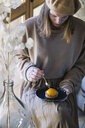 Woman eating peach tarlet - ALBF00834