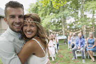Portrait enthusiastic bride and groom at backyard wedding - HEROF28737