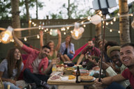 Friends dinner party taking selfie with selfie stick - HEROF28842