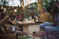 Friends enjoying backyard dinner party - HEROF28845
