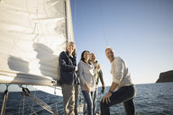 Smiling friends on sunny sailboat - HEROF29067