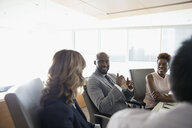 Business people talking in conference room meeting - HEROF29253