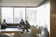 Business people working in highrise office lounge - HEROF29262