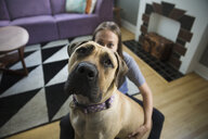 Portrait dog and woman in living room - HEROF29611
