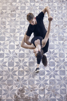 High angle view of ballet dancers dancing together on floor in old building - CAVF63259