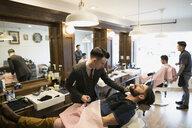 Barber grooming man - HEROF29724
