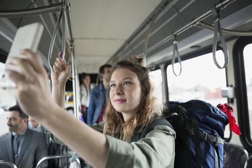 Young woman taking selfie on bus - HEROF29830