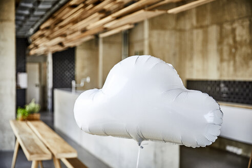 Cloud balloon floating in creative office - FMKF05436
