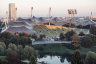 Germany, Munich, Olympic Park, Olympic Stadium, tent roof construction in the morning light - WFF00039