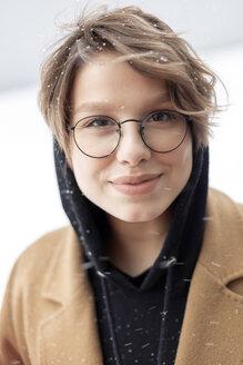 Portrait of young woman at snowfall - VGF00246