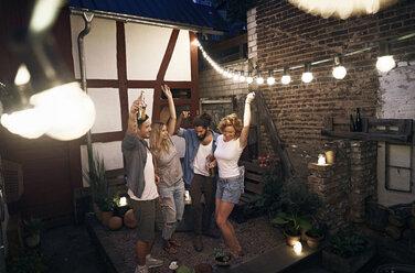 Friends having fun, dancing at a backyard party - PDF01879