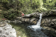 Germany, Upper Bavaria, Bavarian Prealps, lake Walchen, young man is jumping into a plunge pool - WFF00062