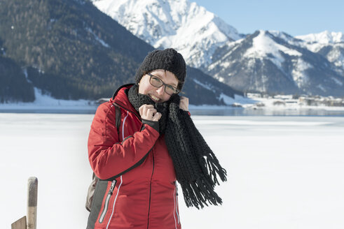 Austria, Tyrol, Achensee, portrait of smiling woman in winter - MKFF00456