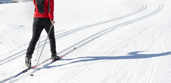 Austria, Tyrol, Achensee, close-up of man doing cross country skiing - MKFF00459
