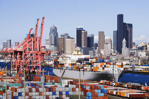 Commercial dock with city in background, Seattle, Washington, United States - MINF11013