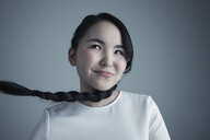 Portrait mischievous Asian young woman with long black braided hair - HEROF30084