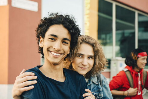 Portrait of smiling teenage boy with friend in city - MASF11771