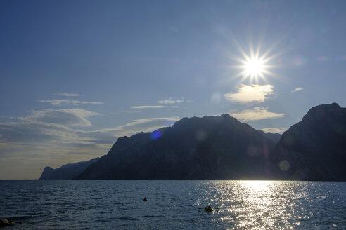 Italy, Trentino, Torbole, sunshine over Lake Garda - LBF02454
