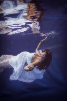 Pregnant woman wearing white dress under water - STBF00267