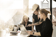 Creative businesswomen working together in office - MJRF00136
