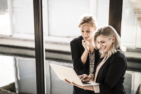 Creative businesswomen working together in office - MJRF00139