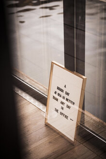 Sign with a saying on a housebout - MJRF00148